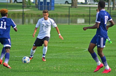 Midfielder Christian Sosnowski passes the ball between St. Ambrose defenders Wednesday at Lakeside Field. The Panthers defeated the Fighting Bees 2-1.