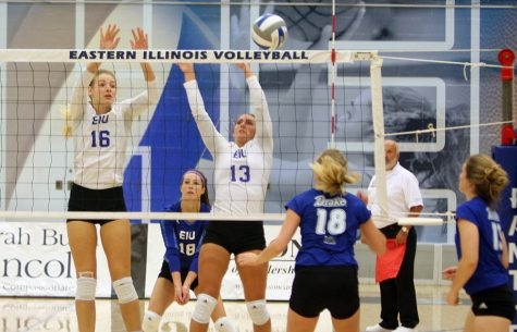 Freshman middle hitter Maggie Runge (left) and junior outside hitter Maria Brown (right) go up for the block against a hit from a Drake opponent during the Panthers' match on Friday, Sept. 9, in Lantz Arena. The Panthers lost to Drake, 1-3. Eastern will face Southern Illinois Edwardsville on the road tonight at 6 p.m.