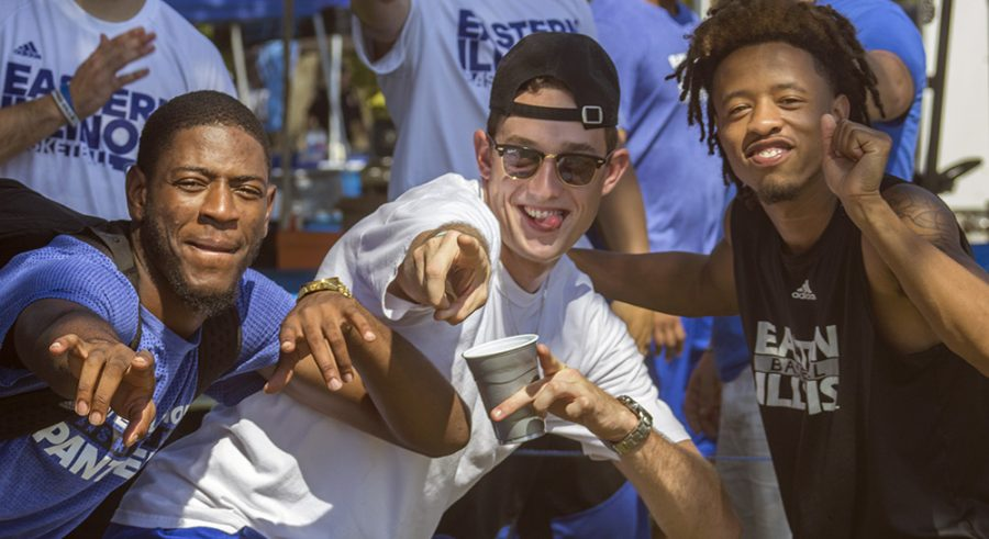 """Basketball players Ray Crossland, Patrick Muldoon and Cornell Johnston hang out and pose for pictures during """"EIU Tailgating"""" Saturday behind O'Brien Field. Muldoon said he feels a bond with his teammates as if they were blood. """"Every time we break huddle we say """"one, two, three, family,"""" Muldoon said."""