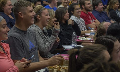 "Audience members laugh at Donald Trump's rebutal to a question reguarding his tax information during the Presidential Debate Monday in Lumpkin Auditorium. Addison Bounds (grey Adidas shirt), a senior marketing major, said he thought this part of the debate was especially laughable because Trump's response was ""just very off topic."""