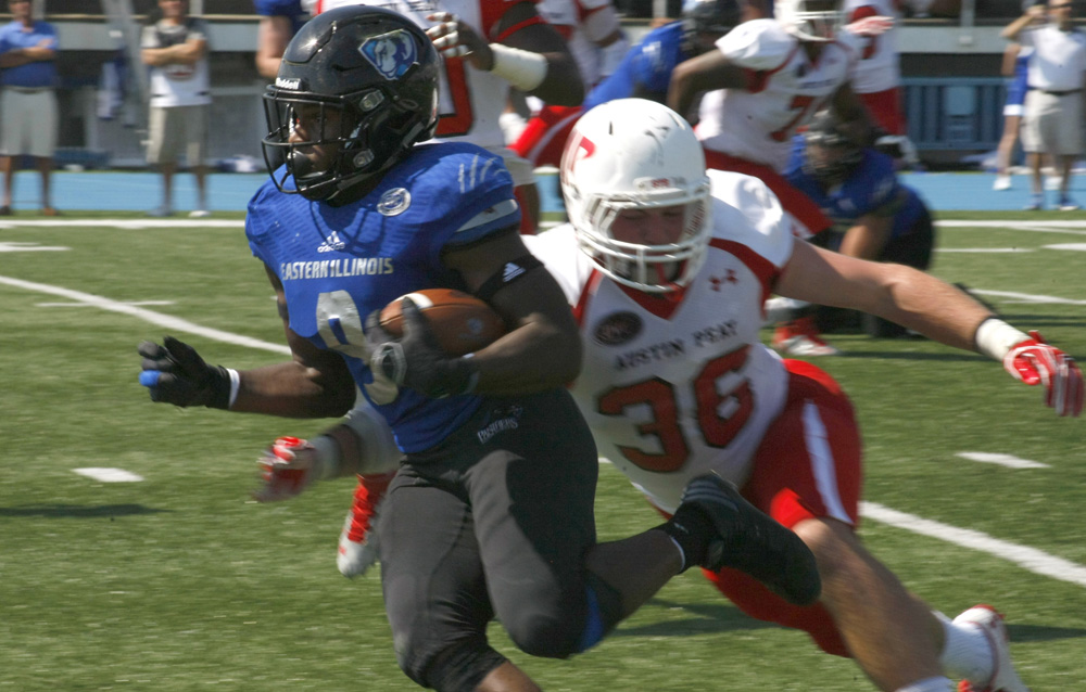 Devin Church outruns an Austin Peay defender Saturday at O'Brien Field. Church carried the ball 16 times for 139-yards and one touchdown in the 56-35 win over the visiting Governors.