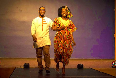 Ernest Echefu, a graduate student and Samira Issaka, a senior chemistry major walk the stage during the Global Cultural Night fashion show in the Grand Ballroom of the Martin Luther King Jr. University Union. Issaka hails from Ghana and Echefu is from Nigeria.