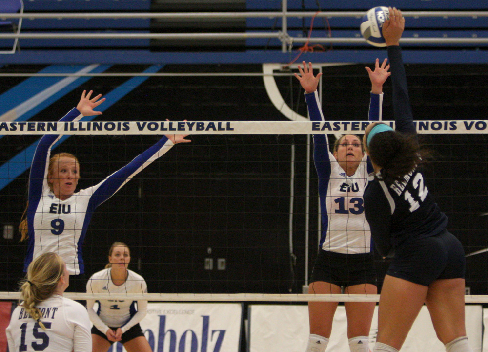 Maria Brown (13) and Allie Hueston (9) attempt a block from Belmont hitter Friday, Sept. 23 at Lantz Arena. Brown finished the match witha block and 11 digs in the 3-1 loss.