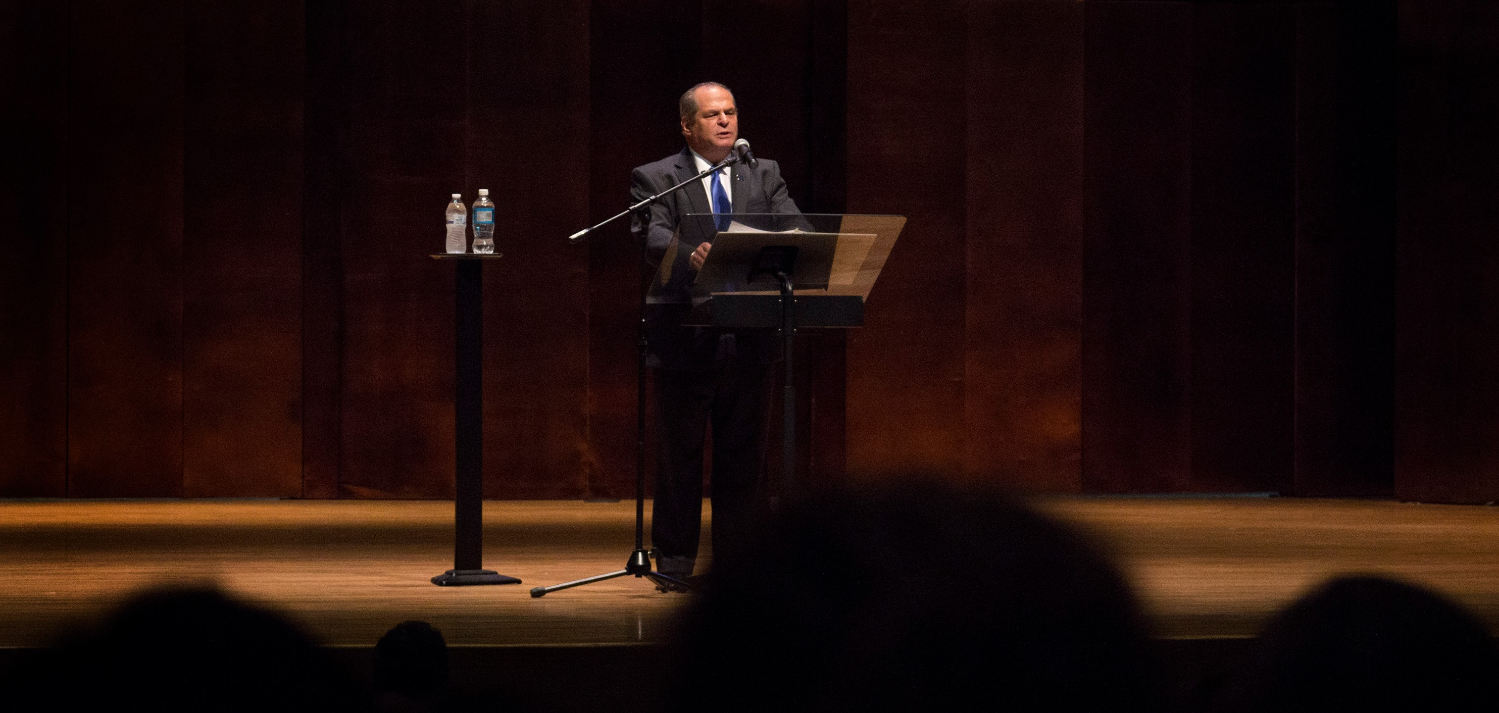 President David Glassman speaks of the negative impact on Eastern's reserve funds due to low enrollment and the state's inability to pass a budget this past fiscal year during the State of the University Address in the Dvorak Concert Hall of the Doudna Fine Arts Center Wednesday.