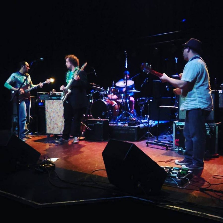 The band Brainchild performing one of their songs at the Limelight Eventplex in Peoria.