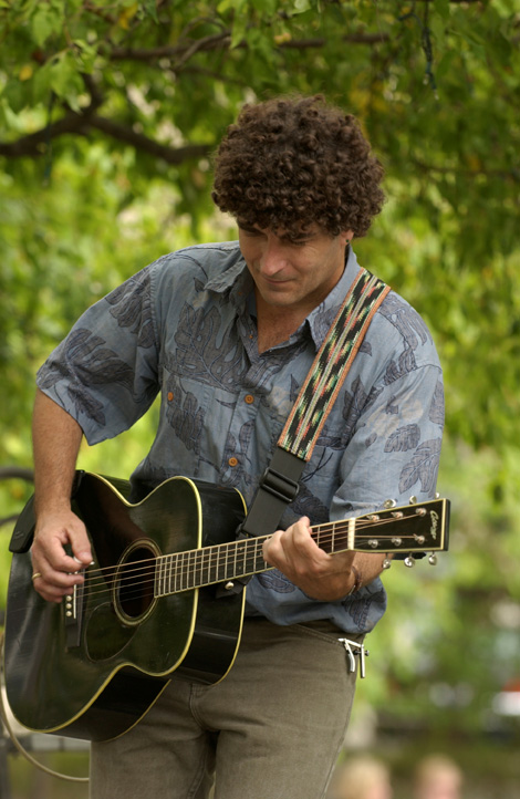 Chris Vallillo playing his guitar. He plays more than three instruments.