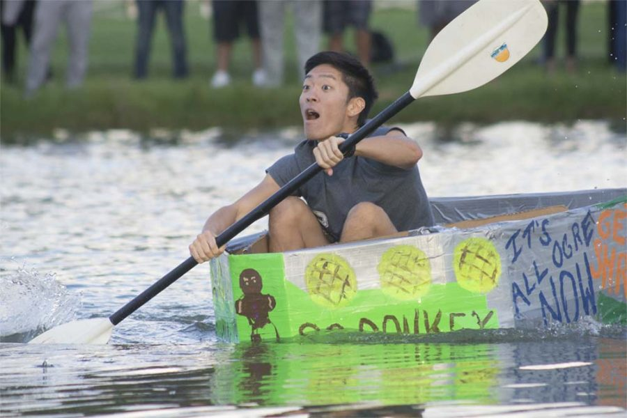 """Ichiro Ohira, a junior communication studies major competes during the boat relay at the campus pond Thursday. Ohira participated for the first time this year.  When asked about the experience Ohira said, """"As always I had a good time, it was a lot of fun."""""""
