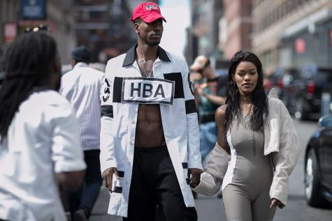 Professional basketball player Iman Shumpert and his fiance', actress Teyana Taylor, in Hood by Hair designs at New York Fashion Week 2016. Taylor modeled in Kanye West's Yeezy 2017 season showcase during the week's festivities.
