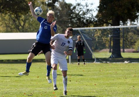 Freshman defender Anton Olsson attempts to ground a high ball sent down the field from Fort Wayne goalkeeper Jorge Trujillo during the Panthers' 1-0 win Sunday at the west practice field. Olsson had one shot in the match.