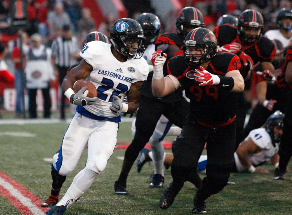 Korliss Marshall runs into a wall of SEMO defenders Saturday at Houck Stadium. Marshall carried the ball 8 times for 18 yards in the Panthers 21-14 loss.
