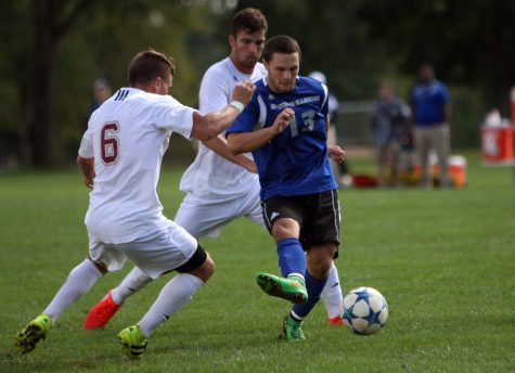 Sophomore forward Trevor Kerns battles two Denver opponents for possession of the ball during the Panthers' 1-0 loss to Denver Saturday.