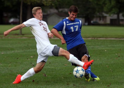 Sophomore midfielder Tyler Massa fights for possession during the Panthers' 1-0 loss to Denver Saturday. The Panthers will begin a 4-game road trip Wednesday.