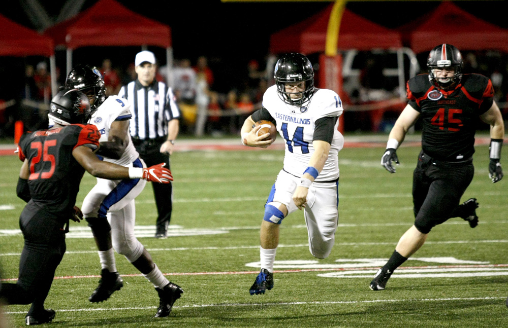 Quarterback Austin Green scrambles with the ball Saturday at Houck Stadium in a 21-14 loss to SEMO. Green carried the ball seven times for 18 yards and passed for 188 yards completing 19-of-33 attempts.