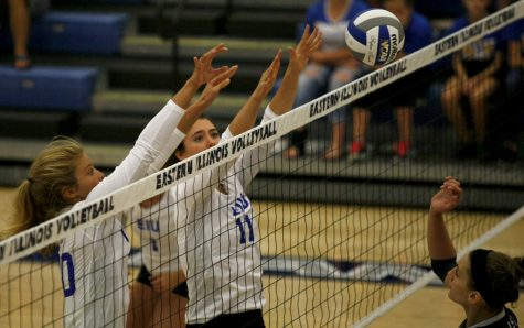 Sophomore Abby Knight (11) and Freshman Katie Sommer go up for a block Friday, Sept. 9 at Lantz Arena.