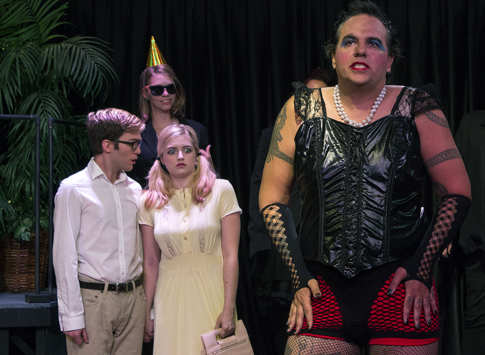 """Kali Wolf, the actor playing Dr. Frank-N-Furter, sings """"Sweet Transvestite"""" during a dress rehersal Tuesday in the Mattoon Train Depot."""