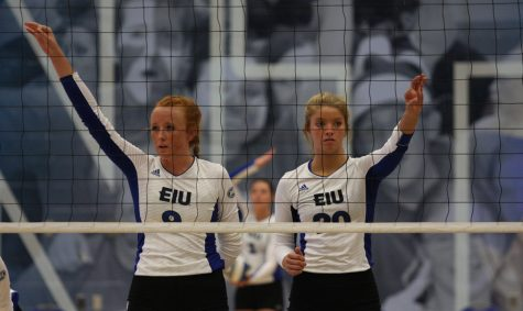 Allie Hueston (left) and Katie Sommer (right) spot their teammates as Josie Winner (center back) prepares to serve the ball Friday at Lantz Arena.