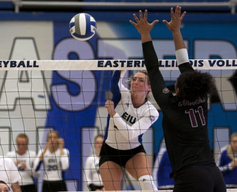Junior outside hitter Maria Brown kills the ball past an Eastern Kentucky opponent during the Panthers' 3-2 loss Friday in Lantz Arena. Brown had a season high 20 kills against the Colonels.
