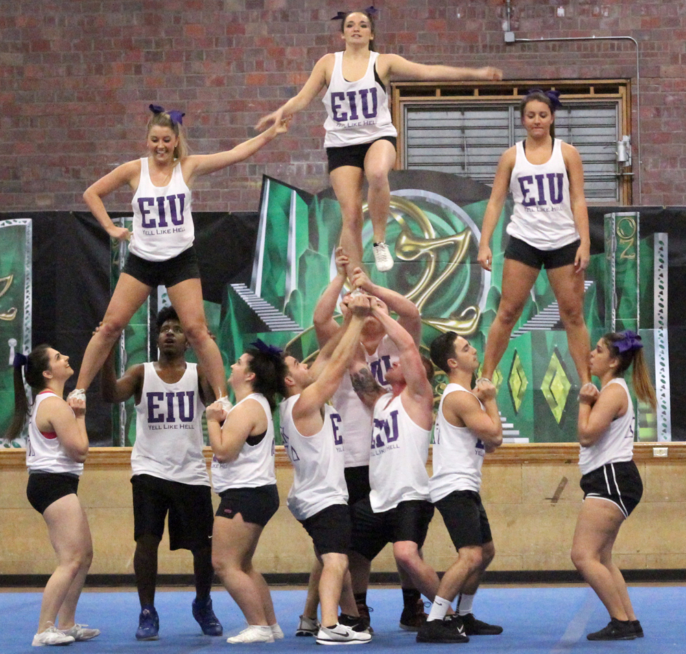 Members of Sigma Kappa sorority and Delta Tau Delta fraternity perform their cheer for the crowd at the