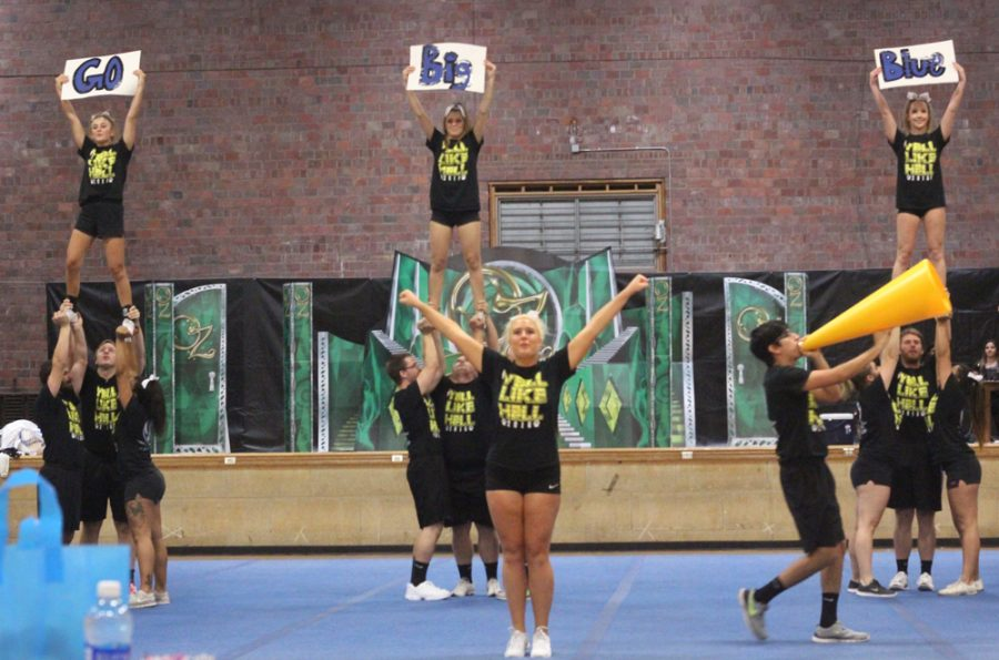 Members of Delta Delta Delta and Phi Kappa Theta fraternity perform their routine which earned them second place at the OZ-SOME Yell Like Hell pep rally in McAfee gym Friday.