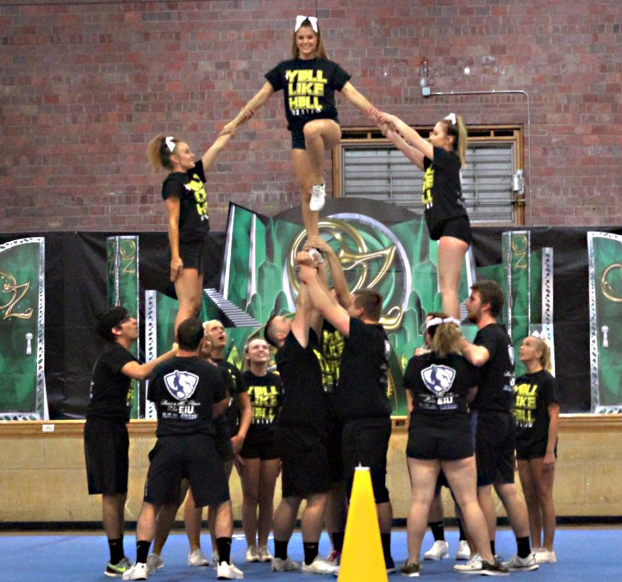 Members of Delta Delta Delta sorority and Phi Kappa Theta perform their cheer routine in McAfee Gym at the OZ-SOME pep rally Friday night.