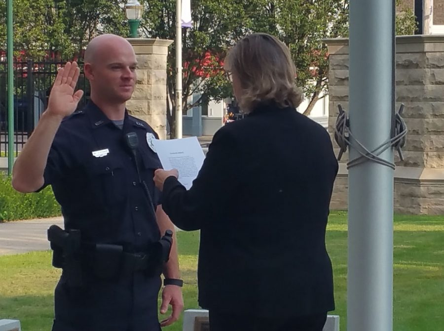 Joel Stewart, the new university police officer, is sworn in by Lynette Drake, the interim vice president for student affairs earlier this month.