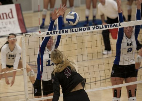 Redshirt freshman Gina Furlin blocks Eastern Kentucky's Nikki Drost's kill attempt Friday. Oct. 14 in Lantz Arena. The Panthers fell 3-2 to the visiting Colonels.