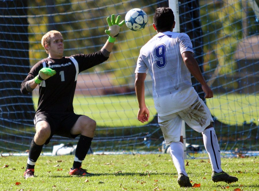 Junior goalkeeper Mike Novotny blocks a shot by Fort Wayne junior midfielder Edel Ensaldo Bustos during the Panthers' 1-0 win Oct. 23, 2016 at the west practice field. Novotny made six saves in the match.