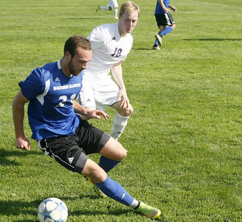 Senior Davis Wegmann fights for ball control with Western Illinois' defender Jamison Kozar Saturday at Lakeside Field. The Panthers defeated the Leathernecks 2-0 for their third win in a row.
