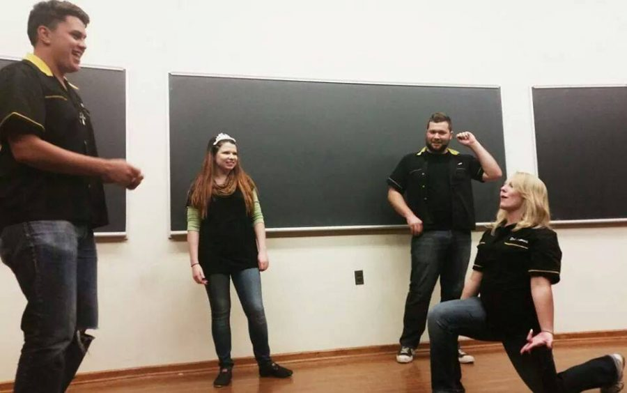 Previous members of the organization Hello Dali acting out a scene. The group does improv comedy in front of a crowd of about 35 people every two weeks.