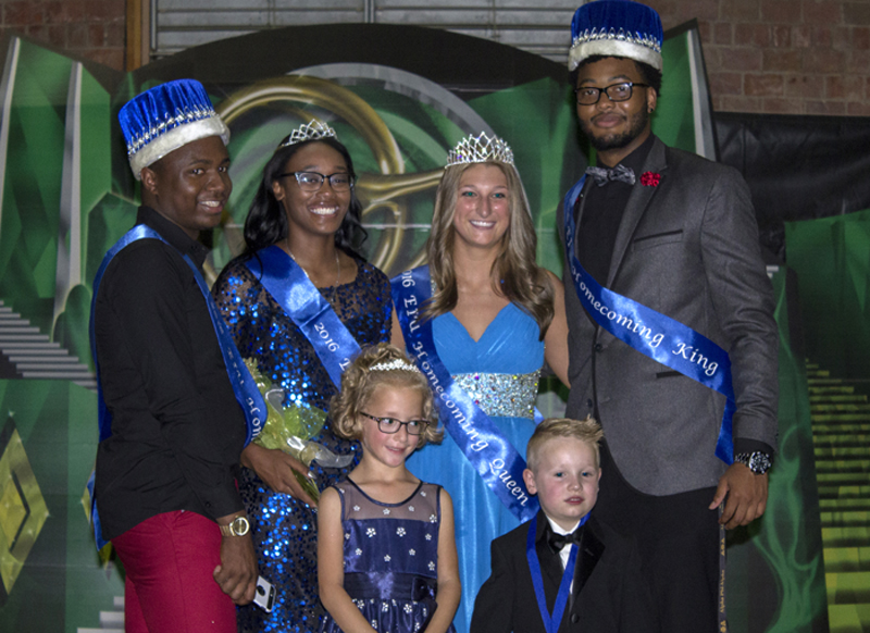 The 2016 Homecoming Court poses for a photo after being crowned at the Wizard of Paws Coronation Ceremony Monday night in the McAfee Gym. In order from left to right, sophomore Parish Amos (prince), junior Khayla Kelley-Morton (princess), senior Catie Witt (queen), senior Justin Earls (king), Joleigh Hills (little princess), and Evan Reifsteck (little prince).