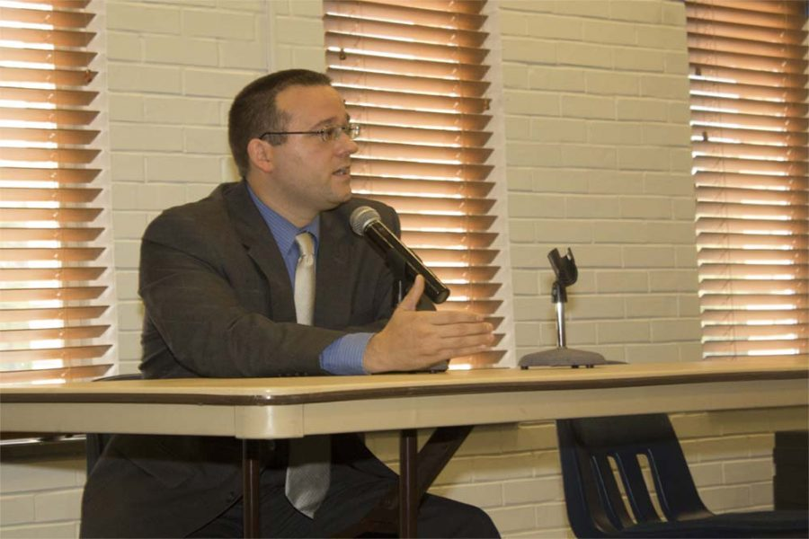 Dennis Malak, Democratic candidate for Illinois' 110th represenative district, sits next to an empty chair and answers questions from community members during a forum Wednesday at the Martin Luther King Jr. University Union. Reggie Phillips, the incumbent representative, was not in attendance.