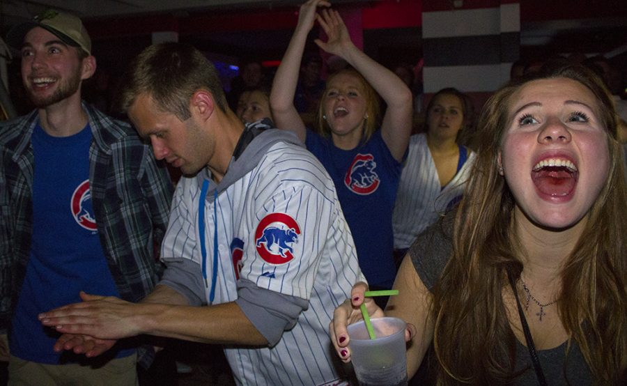 Students cheer as the Cubs break the six to six tie in the extra inning of the World Series Wednesday night at the Penalty Box.