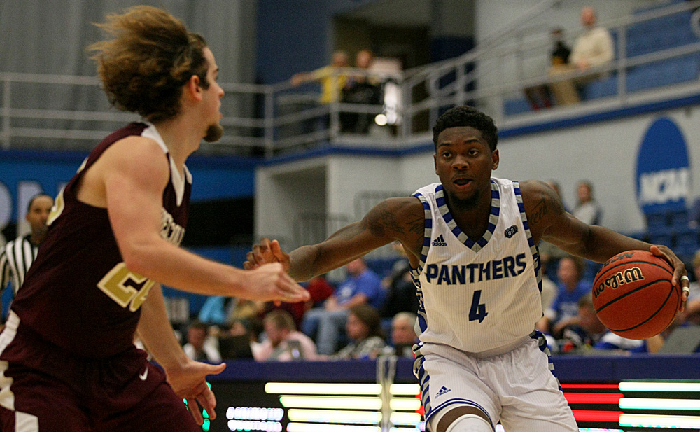 Junior guard Montell Goodwin drives into the lane against Eureka's Hank Thomas Sunday at Lantz Arena. The Panthers defeated the Red Devils 94-58 in it's only exhibition game before the season opener Friday against Saint Francis.