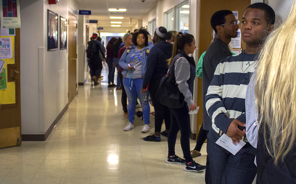 Students stand in line, waiting to register to vote in Coles County Monday in the hallway leading into the Bridge Lounge of the Martin Luther King Jr. University Union. Some students waited as long as two hours to register and vote in the same day.