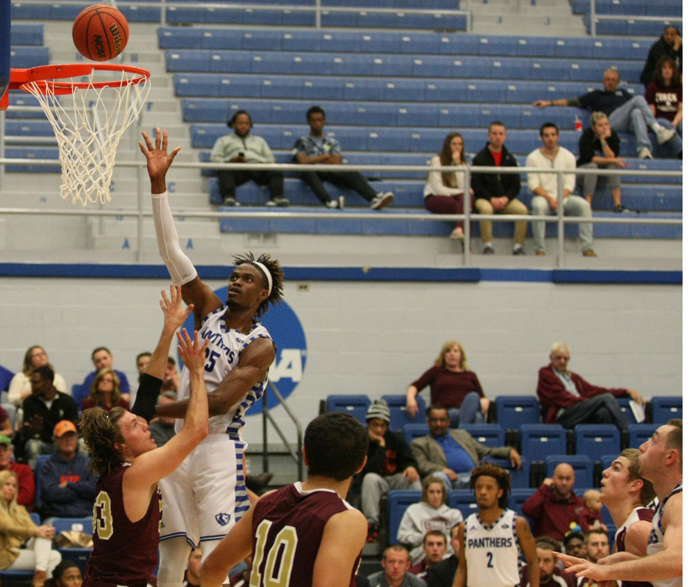 Junior Muusa Dama lays in a basket Sunday against Eureka College at Lantz Arena. Dama scored 14 points and recorded 3 blocks in the 94-58 exhibition game win.