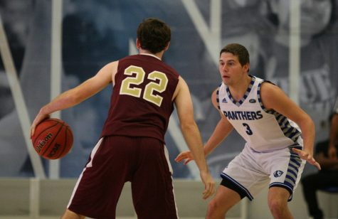 Casey Teson, a sophomore gaurd defends the dribble from a Eureka gaurd Sunday at Lantz Arena. Teson scored nine points going 3-10 from the field and 1-5 from three point range.