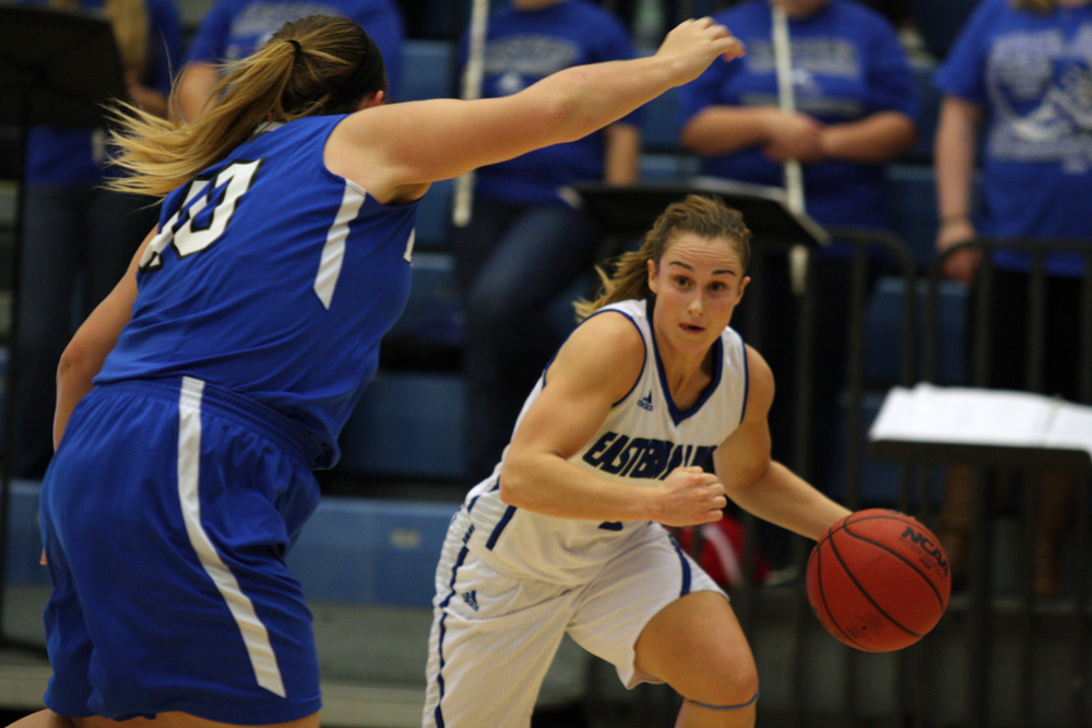 Junior guard Grace Lennox attempts to dribble around a Millikin defender during the Panthers' 97-54 win over Millikin Friday in Lantz Arena.