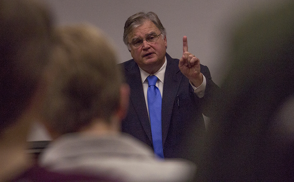 """David Yepsen, the former executive director of the Paul Simon Public Policy Institute, talks about Trump's 2016 election campaign in regards to the president-elect's targeted audience, which he described as, """"non-college whites"""" during the Edgar Speaker Series Monday in Lumpkin Auditorium."""