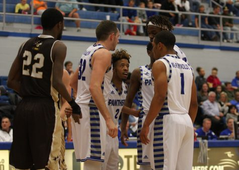 Junior guard Cornell Johnston, center, talks with his teammates after a time out against St. Francis Friday night in Lantz Arena. The Panthers won 83-41.