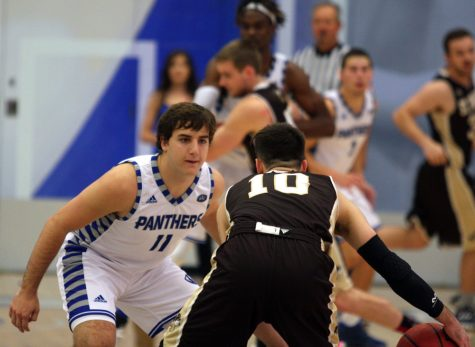 Freshman guard Logan Koch puts pressure on a St. Francis opponent during the Panthers' 83-41 win Friday, Nov. 11 in Lantz Arena.