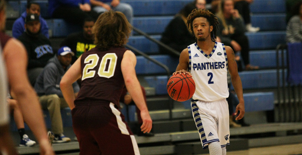 Junior guard Cornell Johnston looks eyes the court for an open teammate Sunday Nov. 6 at Lantz Arena. The Panthers defeated the Red Devils 94-58 in their only exhibition game of the season.