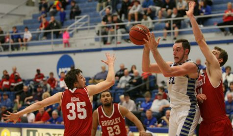 Sophomore forward Patrick Muldoon hauls in one of his two rebounds Tuesday against Bradley at Lantz Arena. The Panthers record moved to 4-3 after the 87-83 loss to the visiting Braves.