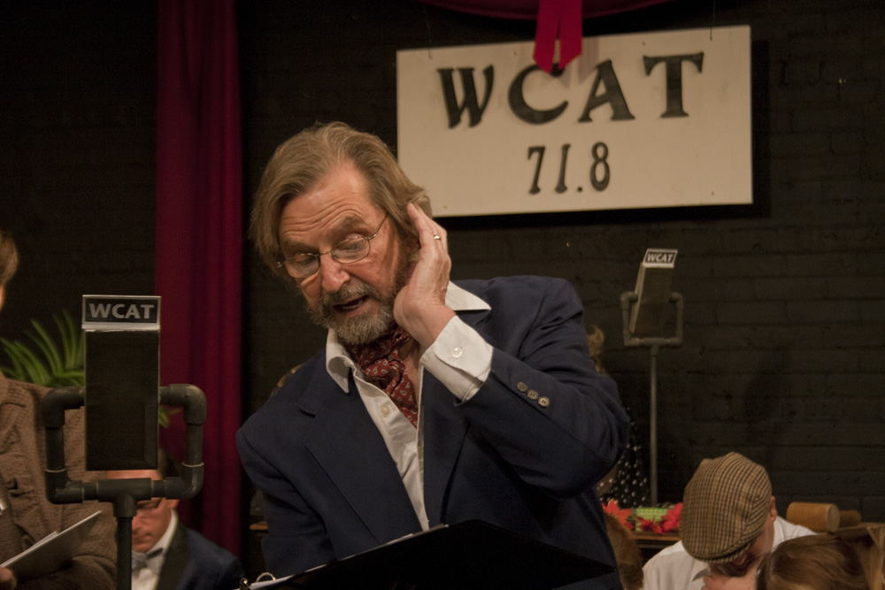 Angelica Cataldo | The Daily Eastern News  CAT board member and actor, Duke Bagger plays the radio narrator in Charleston Alley Theatre's production of