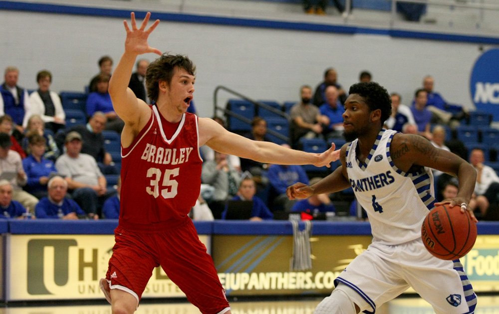 Junior guard Montell Goodwin drives toward the basket against a Bradley defender Tuesday in Lantz Arena. Goodwin finished with six points and seven assists in the 87-83 loss.