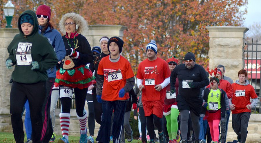 Runners of all ages participated in Saturday's fifth annual Holiday Hustle which began and ended at the gates outside of Old Main.