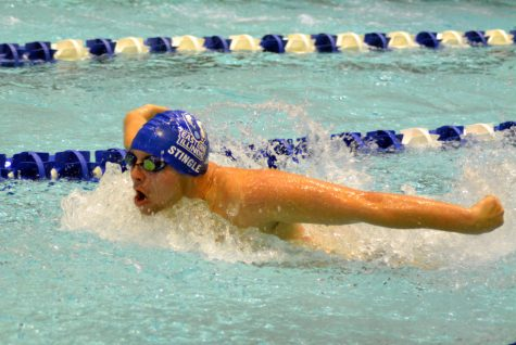 Sophomore Gerald Stingle swims the 2nd leg of the 300-yard butterfly relay Saturday at Padovan Pool.