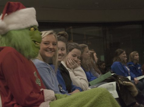 English major Heather Lamb mingled among the crowd in the Tarble Arts Center while dressed in a Grinch costume. Lamb was accompanied by English major Brandon Berglund dressed as Grinch's dog, Max.