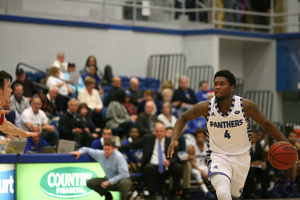Junior guard Montell Goodwin dribbles down court during the Panthers' 87-83 overtime loss to Bradley Nov. 29.