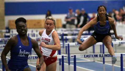 Sophomore Shirley Jones clears a hurdle during Saturday's EIU Early Bird meet at Lantz Fieldhouse. Jones finished the 60-meter hurdle event with a time of 9.82 seconds.
