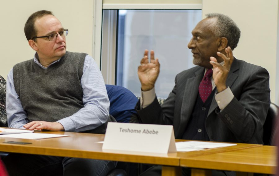 Music professor, Stefan Eckert (left) and Economics professor Teshome Abebe (right) discuss the recommendations made by Workgroups in the vitalization project that were posted on the project's webpage Monday.